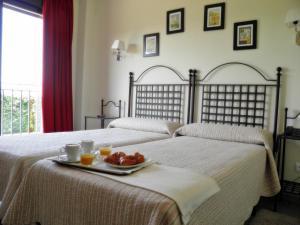 Cama o camas de una habitación en Hotel El Rondón