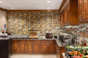 A kitchen or kitchenette at Homewood Suites by Hilton Orlando-Intl Drive/Convention Ctr