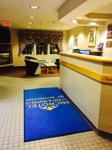 The lobby or reception area at Microtel Inn & Suites by Wyndham Syracuse Baldwinsville