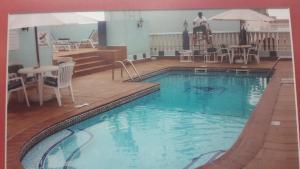 The swimming pool at or near Jonrad Hotel
