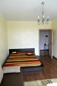 Кровать или кровати в номере Апартаменты на Тургенева 10г
