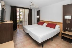 Cama o camas de una habitación en Catalonia Oro Negro