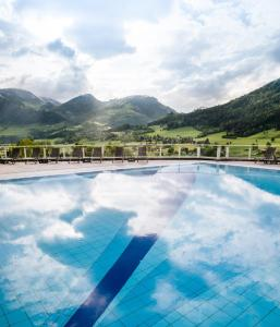 The swimming pool at or near IMLAUER Hotel Schloss Pichlarn