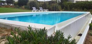 The swimming pool at or near Casa Rio da Prata