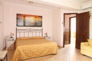 Letto o letti in una camera di Hotel Borgo Eolie