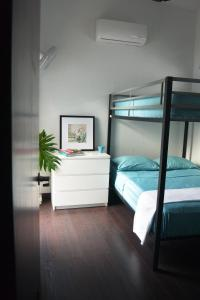A bunk bed or bunk beds in a room at Zen Retreat City Centre
