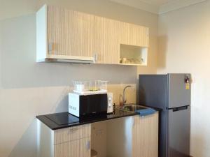 A kitchen or kitchenette at My Resort Hua Hin