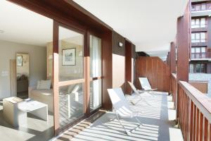 A bunk bed or bunk beds in a room at Résidence Prestige Odalys Le Panoramic