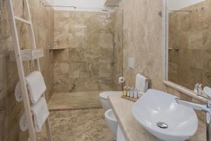 A bathroom at Falkensteiner Resort Capo Boi