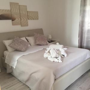 Ein Bett oder Betten in einem Zimmer der Unterkunft B&B Corte Salentina