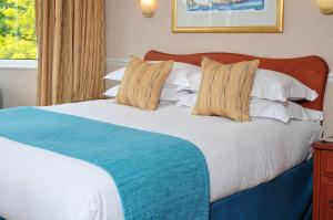 A bed or beds in a room at Bromley Court Hotel London