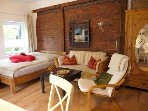 Ein Sitzbereich in der Unterkunft Apartment am Lühedeich