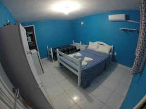 A bed or beds in a room at Pousada La Puerta Del Sol