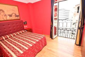 Letto o letti in una camera di Hotel Augustus