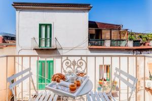 Un balcón o terraza de Palazzo Sassi