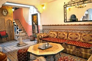 Coin salon dans l'établissement Maison d'hôtes Cité Portugaise