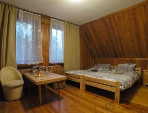 Łóżko lub łóżka w pokoju w obiekcie Base Camp 2 Zakopane