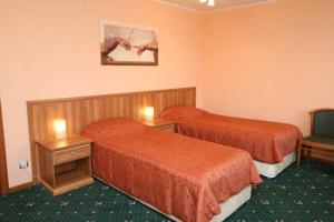 Кровать или кровати в номере Hotel Malahit
