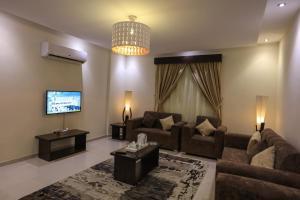 O lounge ou bar de Al Itqan Apart-hotel