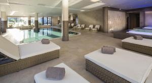 The swimming pool at or near Golden Tulip Aix les Bains - Hotel & Spa