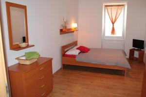 Кровать или кровати в номере Penzion Podzámčí