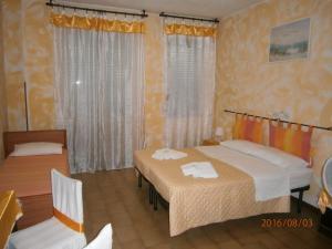 Кровать или кровати в номере Albergo Il Cantuccio