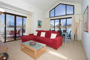 Een zitgedeelte bij Ereza Villas Las Buganvillas