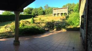 A porch or other outdoor area at O Caseiro de Riba