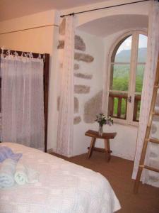Un ou plusieurs lits dans un hébergement de l'établissement Château de Salelles