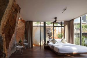 A bed or beds in a room at Nhapha Khaoyai Resort