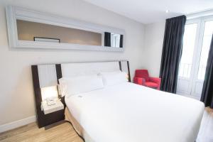 Una habitación en Petit Palace Arenal