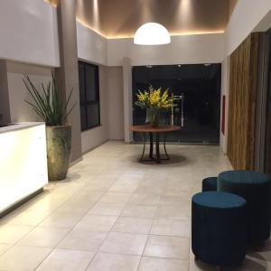 The lounge or bar area at Executive Hotel