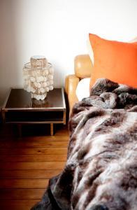 Een bed of bedden in een kamer bij B&B Quatre20cinq