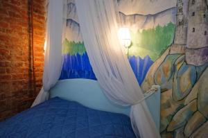 Кровать или кровати в номере Studio on Gorokhovaya 32