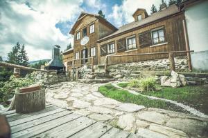 Patio nebo venkovní prostory v ubytování Horská chata Jonáš