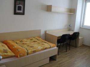 Ein Bett oder Betten in einem Zimmer der Unterkunft Uninova Hostel