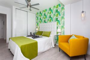 A bed or beds in a room at Bristol Sunset Beach - Holiday Apartments