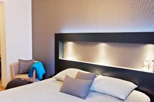 Кровать или кровати в номере Belrom Hotel
