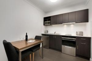 A kitchen or kitchenette at Quest Dandenong
