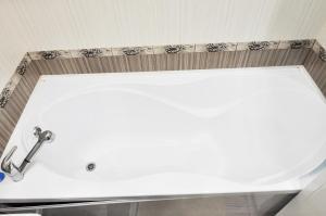 Ванная комната в Apartments at Sheronova 2