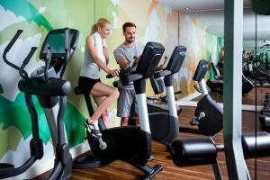 The fitness center and/or fitness facilities at Pullman Munich
