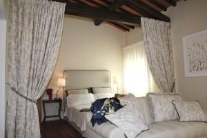 Ein Bett oder Betten in einem Zimmer der Unterkunft Florence View Apartments