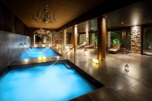 The swimming pool at or near Hotel Castillo de Gorraiz Golf & Spa