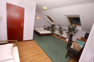 Telewizja i/lub zestaw kina domowego w obiekcie Hotel Baltazar
