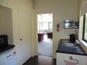 A kitchen or kitchenette at Waiheke Island Punga Lodge