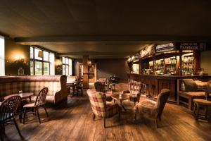 A restaurant or other place to eat at The Deeside Inn