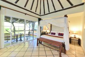 A bed or beds in a room at Supatra Hua Hin Resort