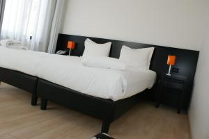 A bed or beds in a room at Hotel Aniene
