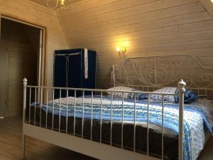 Кровать или кровати в номере Загородный дом с Баней