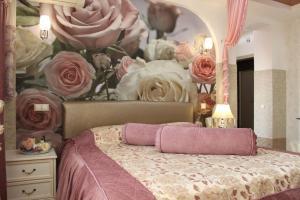 Кровать или кровати в номере Апартаменты на Карла Маркса 116 А - 9 Этаж